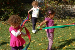 girls play with rainbow streamers