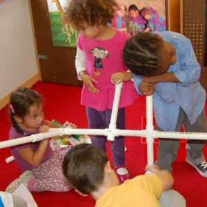 children play with plastic tubing